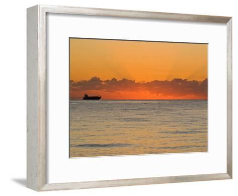 Silhouetted Ship Moments before the Sun Rises over the Horizon-Mike Theiss-Framed Art Print