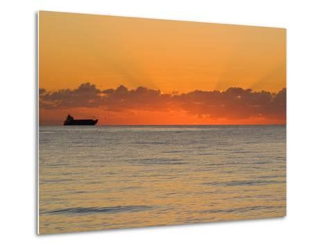 Silhouetted Ship Moments before the Sun Rises over the Horizon-Mike Theiss-Metal Print