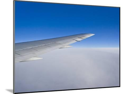 Airplane Just Above Clouds with Sky Split in Blue and White Layers-Mike Theiss-Mounted Photographic Print