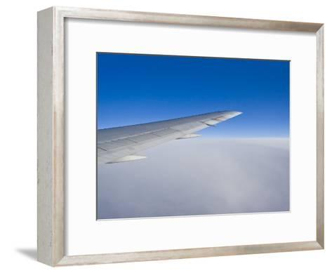 Airplane Just Above Clouds with Sky Split in Blue and White Layers-Mike Theiss-Framed Art Print