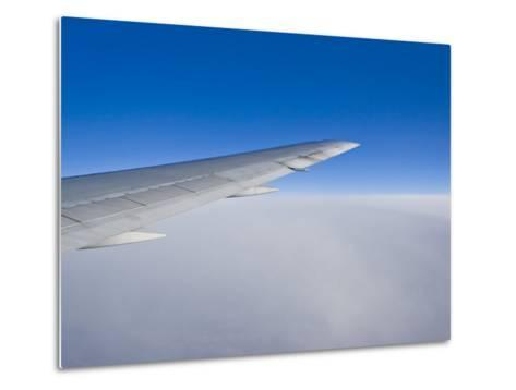 Airplane Just Above Clouds with Sky Split in Blue and White Layers-Mike Theiss-Metal Print