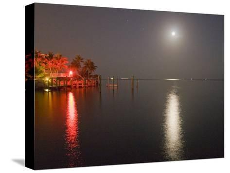 Full Moon and Red Light Reflecting in Water in a Tropical Setting-Mike Theiss-Stretched Canvas Print