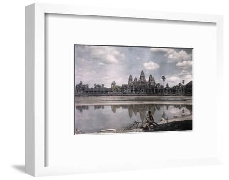 Person Sits by a Moat Which Surrounds the Towers of Angkor Vat-Gervais Courtellemont-Framed Art Print