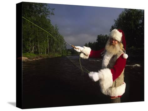 Santa Claus Fly Fishing-Michael Melford-Stretched Canvas Print