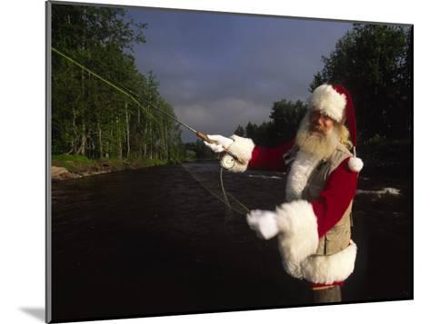 Santa Claus Fly Fishing-Michael Melford-Mounted Photographic Print