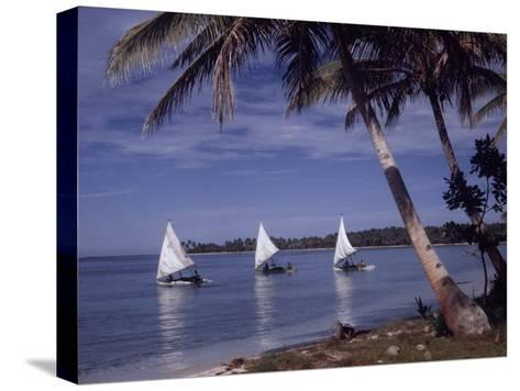 Islanders Visit Various Atolls to Sell and Purchase Goods-W^ Robert Moore-Stretched Canvas Print
