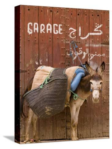 """Mule Parked in Front of a Sign That Reads """"Garage""""-Abraham Nowitz-Stretched Canvas Print"""