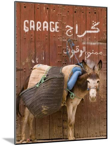 """Mule Parked in Front of a Sign That Reads """"Garage""""-Abraham Nowitz-Mounted Photographic Print"""