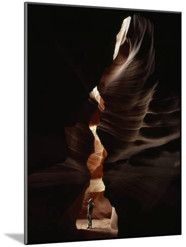 Man Standing in Sunlight in a Narrow Slot Canyon-Paul Chesley-Mounted Photographic Print
