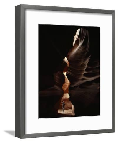 Man Standing in Sunlight in a Narrow Slot Canyon-Paul Chesley-Framed Art Print