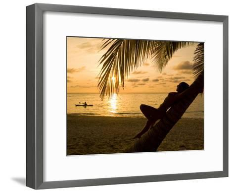 Woman Resting on a Palm Tree at Sunset, Sunset over the Caribbean Sea-Richard Nowitz-Framed Art Print
