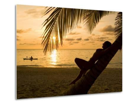 Woman Resting on a Palm Tree at Sunset, Sunset over the Caribbean Sea-Richard Nowitz-Metal Print