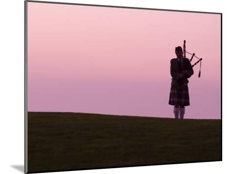 Bagpiper on a Golf Course-Richard Nowitz-Mounted Photographic Print