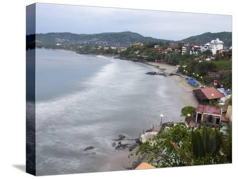 Waves Washing on the Beach in Zihuatanejo Bay Viewed from a Hotel-Rich Reid-Stretched Canvas Print
