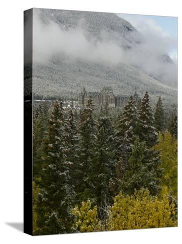 Early Snow Dusts Fall Colored Trees Surrounding Famed Banff Springs Hotel-Gordon Wiltsie-Stretched Canvas Print