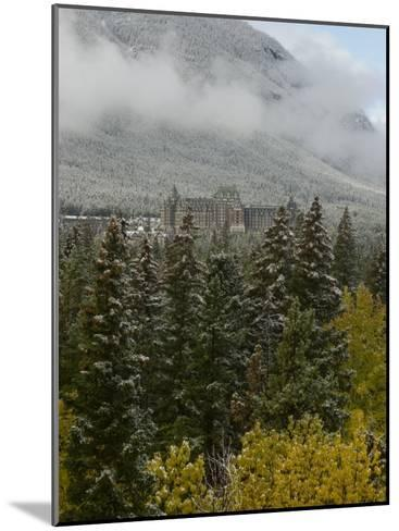 Early Snow Dusts Fall Colored Trees Surrounding Famed Banff Springs Hotel-Gordon Wiltsie-Mounted Photographic Print