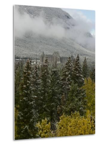 Early Snow Dusts Fall Colored Trees Surrounding Famed Banff Springs Hotel-Gordon Wiltsie-Metal Print