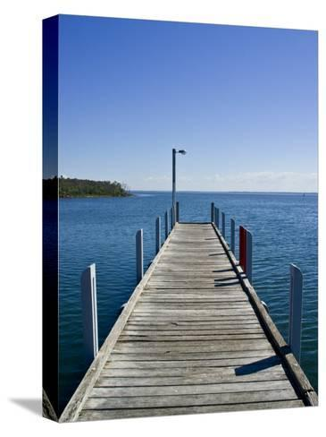 Small Jetty in a Sheltered and Secluded Bay on a Summers Morning-Jason Edwards-Stretched Canvas Print