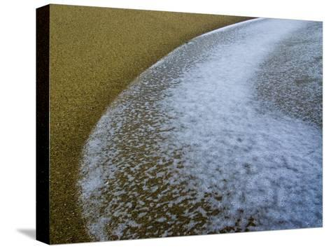 Foamy Edge of a Winter Wave Sweeps onto an Empty Sandy Beach-Jason Edwards-Stretched Canvas Print