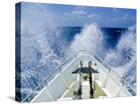Bow of a Ship Ploughs Through Heavy Seas and Spray in Open Ocean-Jason Edwards-Stretched Canvas Print