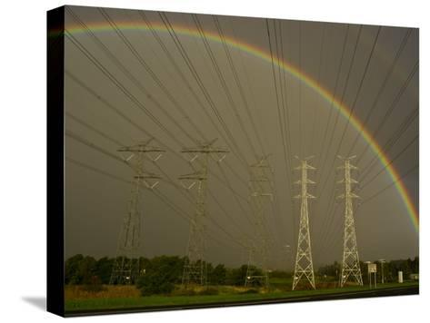 Vast Array of Electrical Towers and Cables Beneath a Huge Rainbow-Jason Edwards-Stretched Canvas Print