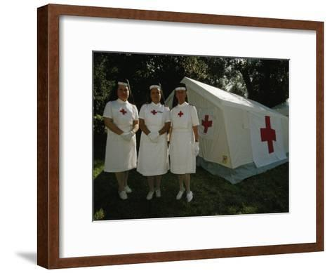 Nurses Stand Ready to Lend Aid at a Horse Jumping Event in Rome-Paul Chesley-Framed Art Print