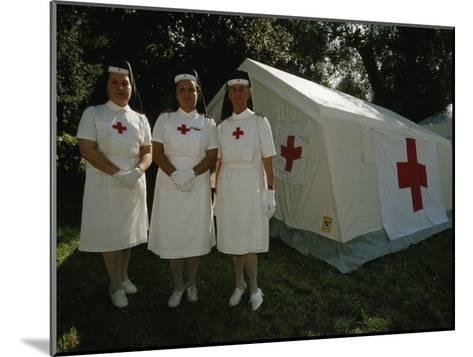 Nurses Stand Ready to Lend Aid at a Horse Jumping Event in Rome-Paul Chesley-Mounted Photographic Print