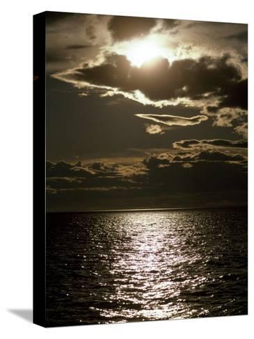 Setting Sun Pierces a Menacing Storm Front over the Atlantic-Jason Edwards-Stretched Canvas Print