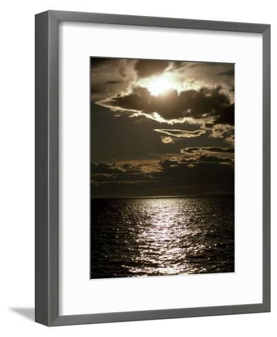 Setting Sun Pierces a Menacing Storm Front over the Atlantic-Jason Edwards-Framed Art Print