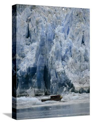 Fishing Boat Dangerously Close to a Crumbling Glacier's Edge-Paul Sutherland-Stretched Canvas Print