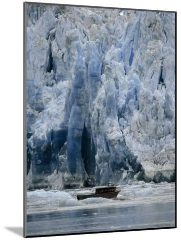 Fishing Boat Dangerously Close to a Crumbling Glacier's Edge-Paul Sutherland-Mounted Photographic Print