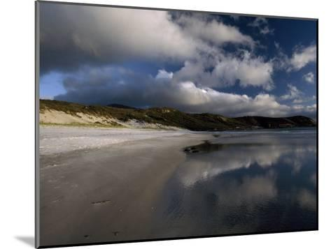 Sunlight Pierces Storm Clouds Illuminating an Empty and Remote Beach-Jason Edwards-Mounted Photographic Print