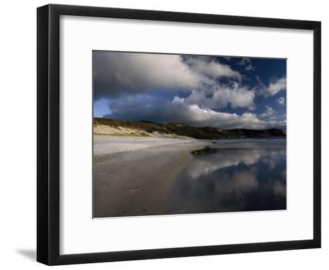 Sunlight Pierces Storm Clouds Illuminating an Empty and Remote Beach-Jason Edwards-Framed Art Print