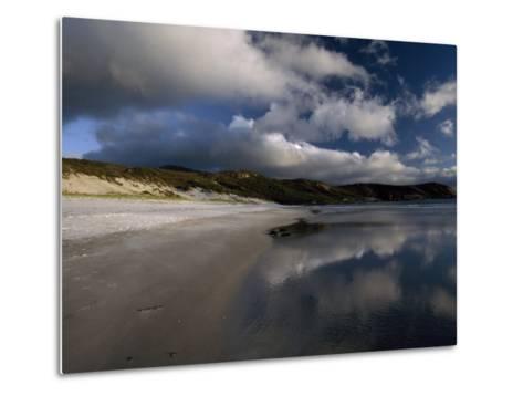Sunlight Pierces Storm Clouds Illuminating an Empty and Remote Beach-Jason Edwards-Metal Print