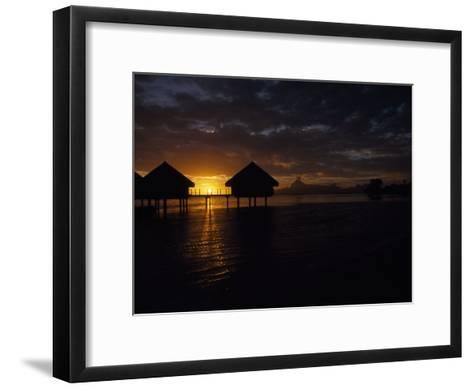 Bungalows over the Water at Sunset at an Exclusive Hotel on Tahiti-Paul Sutherland-Framed Art Print