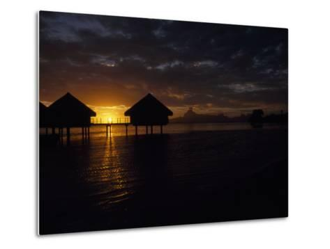 Bungalows over the Water at Sunset at an Exclusive Hotel on Tahiti-Paul Sutherland-Metal Print