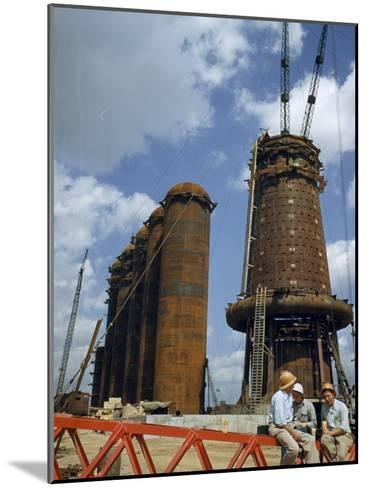 Blast Furnaces Tower over Steel Workers on a Lunch Break-Jack Fletcher-Mounted Photographic Print