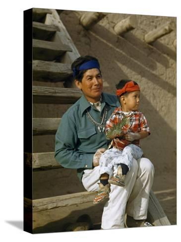 Native American Father and Son Dressed for a Dance Sit Together-Justin Locke-Stretched Canvas Print