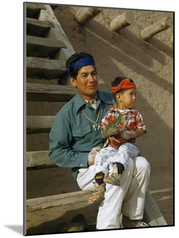 Native American Father and Son Dressed for a Dance Sit Together-Justin Locke-Mounted Photographic Print