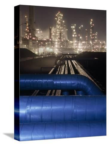 Night View of the Lights of an Oil Refinery-Michael Melford-Stretched Canvas Print