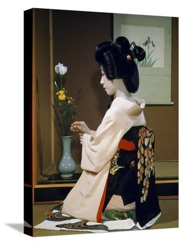 Portrait of a Seated Geisha Wearing Kimono and Obi-Joseph Baylor Roberts-Stretched Canvas Print