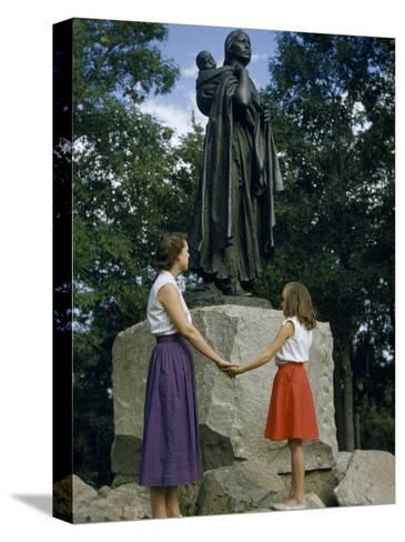 Mother and Daughter Holding Hands Stand Beside Statue of Sacagawea-Ralph Gray-Stretched Canvas Print