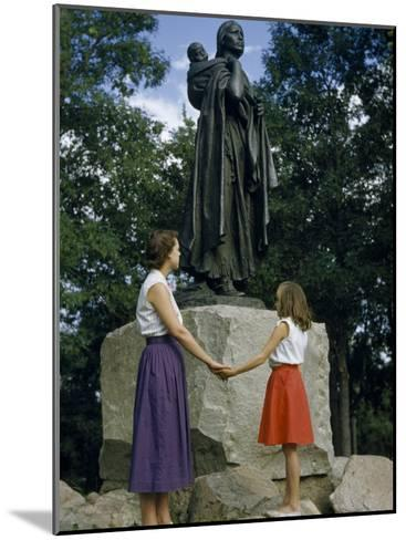 Mother and Daughter Holding Hands Stand Beside Statue of Sacagawea-Ralph Gray-Mounted Photographic Print