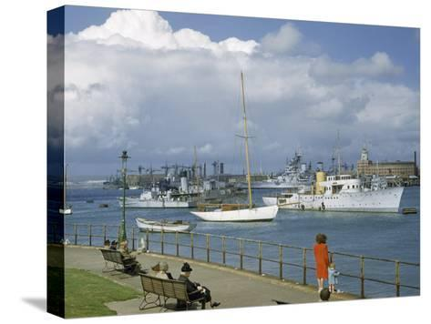 People at Gosport Hard Park Watch Ship Traffic at Naval Dockyards-B^ Anthony Stewart-Stretched Canvas Print