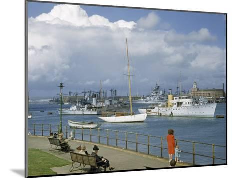 People at Gosport Hard Park Watch Ship Traffic at Naval Dockyards-B^ Anthony Stewart-Mounted Photographic Print