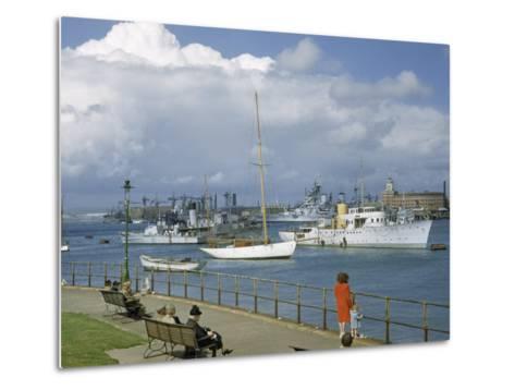 People at Gosport Hard Park Watch Ship Traffic at Naval Dockyards-B^ Anthony Stewart-Metal Print
