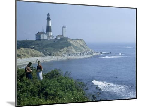 People Stand on Point across Bay from Montauk Point Light-B^ Anthony Stewart-Mounted Photographic Print