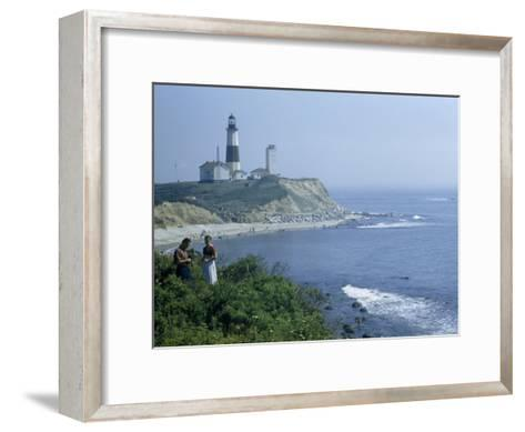 People Stand on Point across Bay from Montauk Point Light-B^ Anthony Stewart-Framed Art Print