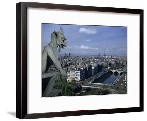 Gargoyle on Notre Dame Looks Down on a Densely Packed Cityscape-Justin Locke-Framed Art Print