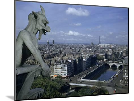 Gargoyle on Notre Dame Looks Down on a Densely Packed Cityscape-Justin Locke-Mounted Photographic Print